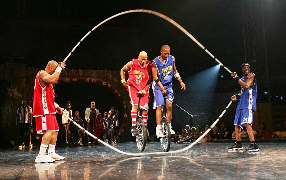 Basketball unicyclist`s team for sport events