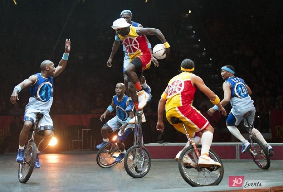 Basketball unicyclist`s team for festivals