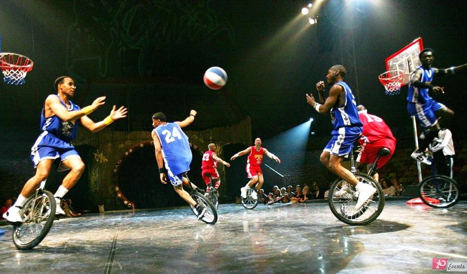 Basketball unicyclist`s team for promotions