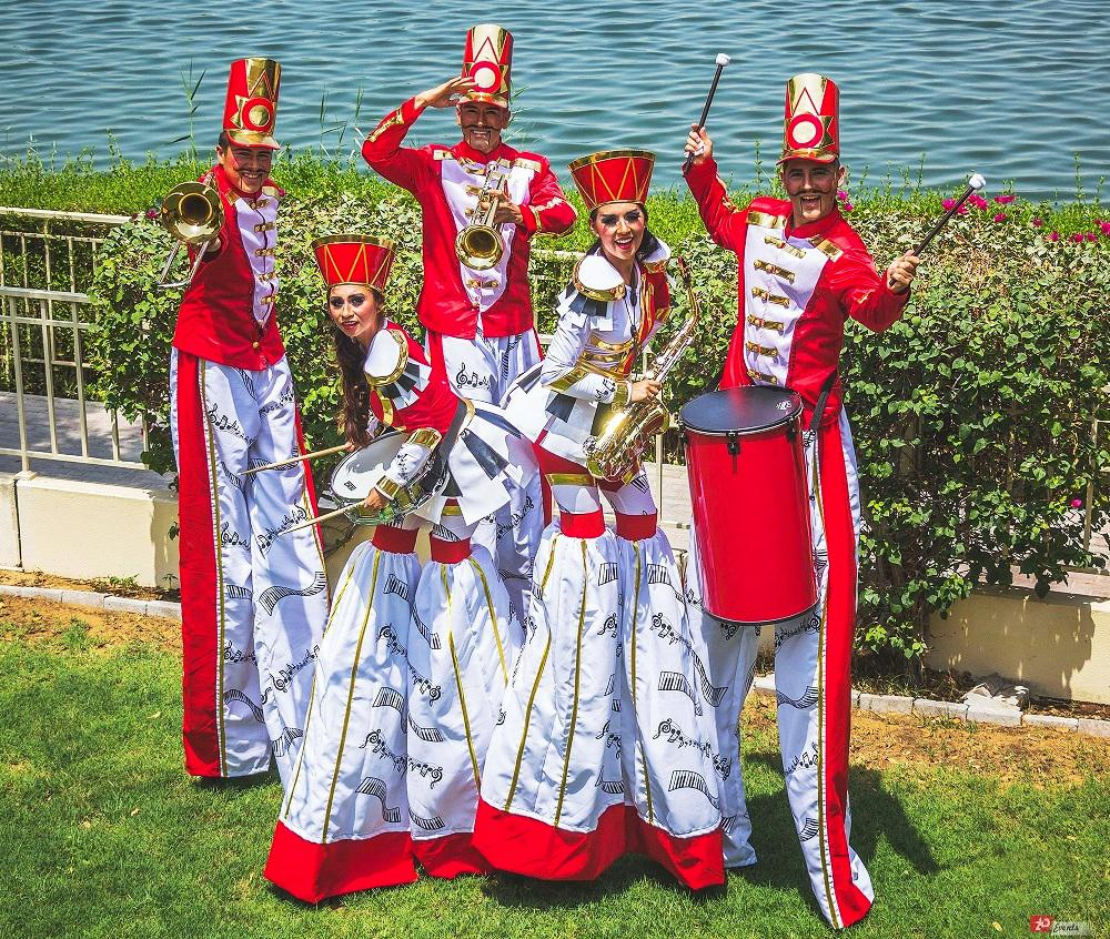 Marching band – stilt walkers parade for themed parties