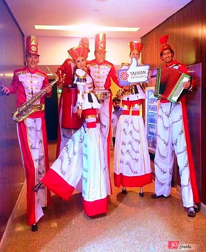 Marching band – stilt walkers parade for mall activities