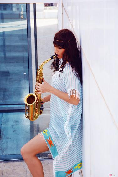 Female sax player for corporate events