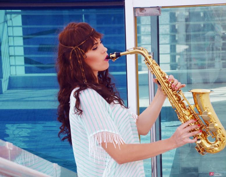 Female sax player for product launch