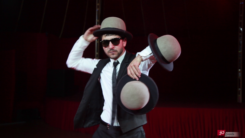 Hat juggler for corporate events