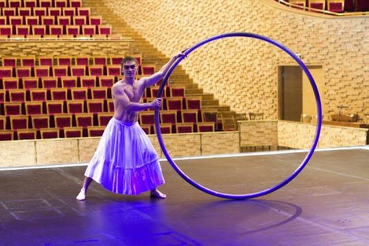 Cyr wheel acrobat for corporate events