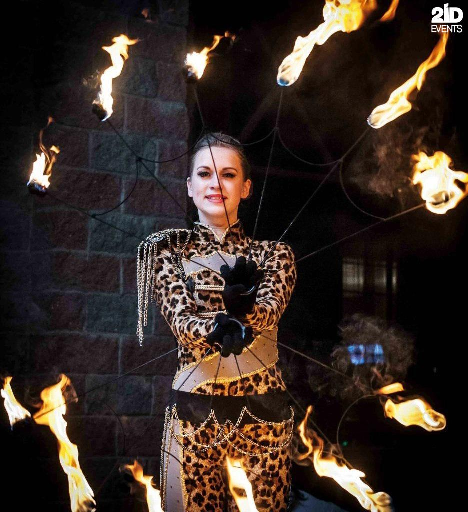Stilt walkers fire show for corporate events