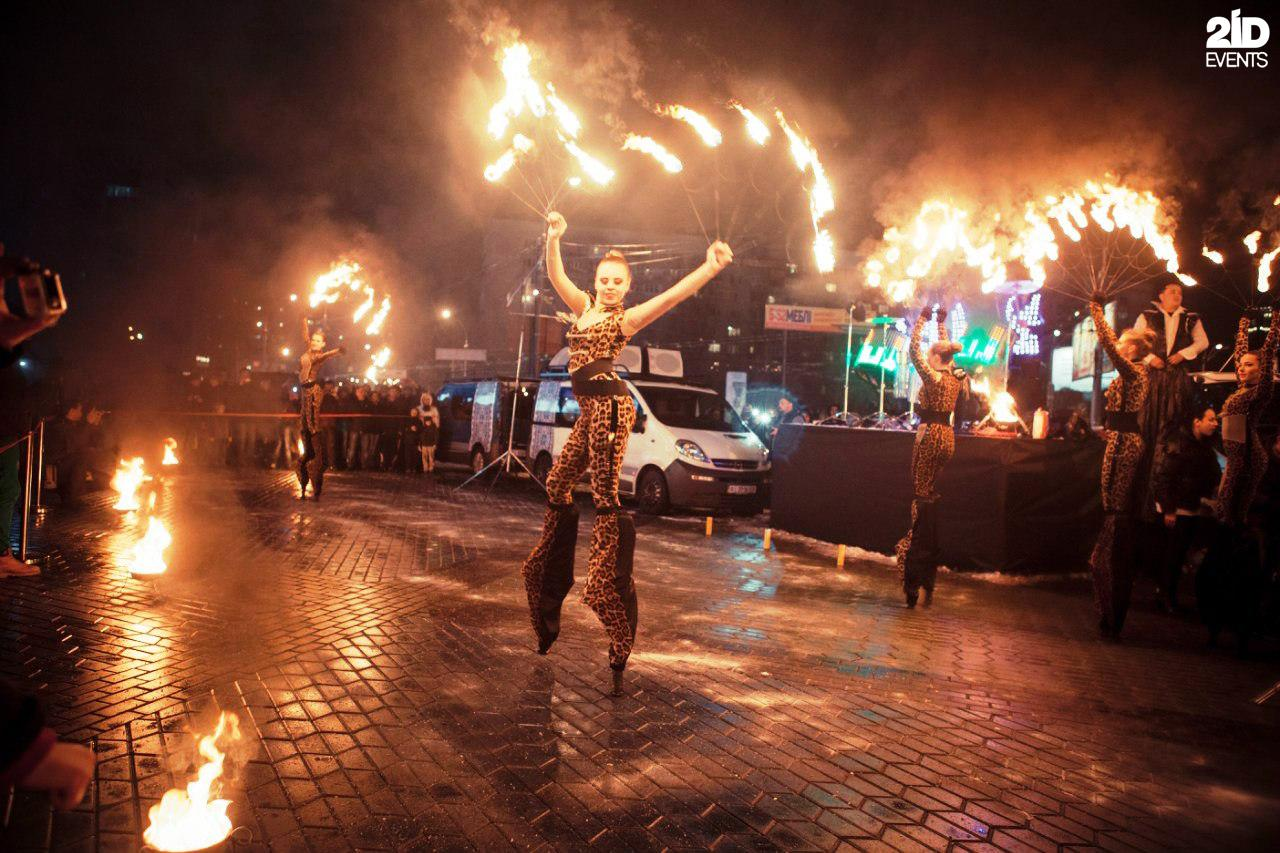Stilt walkers fire show for private events