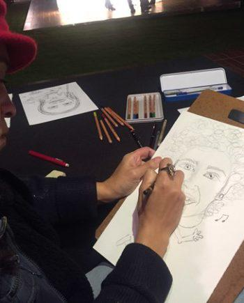 Female caricaturist in Dubai